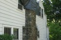 A tree damaged this chimney