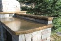 Buffed Concrete Countertop adjacent to the bake oven built by Stichter & Sons Masonry.