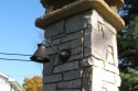 Beautiful lit chimney for outdoor bake oven by Stichter & Sons Masonry.