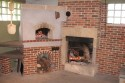 Combination fireplace and bake oven