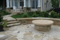 Flagstone walks, patio, benches with covered firepit