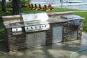 All masonry – grill, side burner, ice bin, trash, storage. Concrete countertop