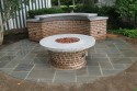 Bluestone patio, tapered brick fire ring base, curved countertop support/ grill support with bluestone toe kick