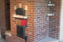 Reclaimed Brick Masonry Heater by Stichter & Sons Masonry. Milford, Indiana. Call (574) 658-4239